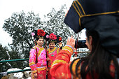 Visitors pose for photos dressed as a Qing Dynasty clothing at Jingshan Park falls on February 20 2015 in Beijing China China celebrated its new...