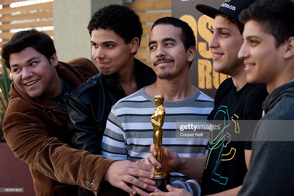 Visitors pose with an Oscar trophey during First-Ever Oscar Roadtrip at the Angelika Film Center on February 18, 2013 in Dallas.