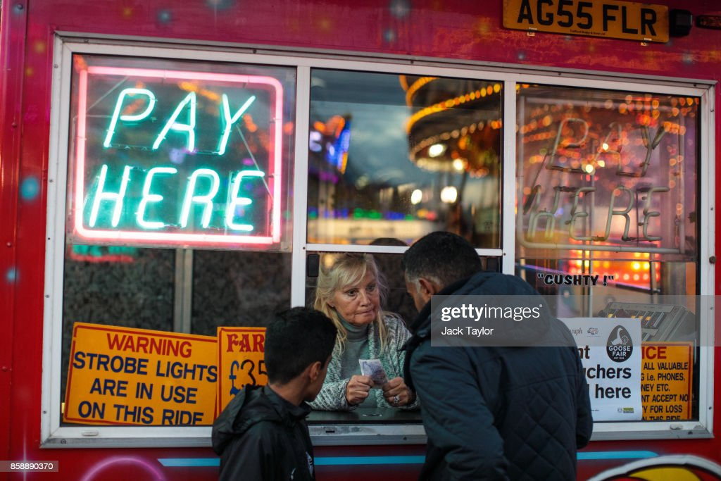 Visitors purchase tickets for a ride at the Nottingham Goose Fair in the Forest Recreation Ground on October 7, 2017 in Nottingham, England. The annual goose fair hosts over 500 attractions for thrill seekers including fun fair classics such as bumper cars, carousels and helter-skelters. The fair is thought to be over 700 years old and its name comes from its origins as a market in the forest grounds where thousands of geese were sold each year.