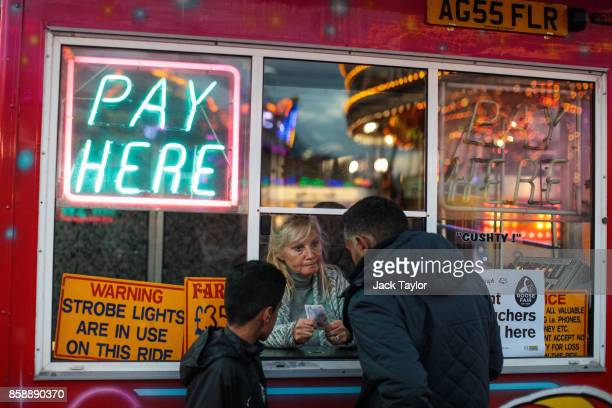 Visitors purchase tickets for a ride at the Nottingham Goose Fair in the Forest Recreation Ground on October 7 2017 in Nottingham England The annual...