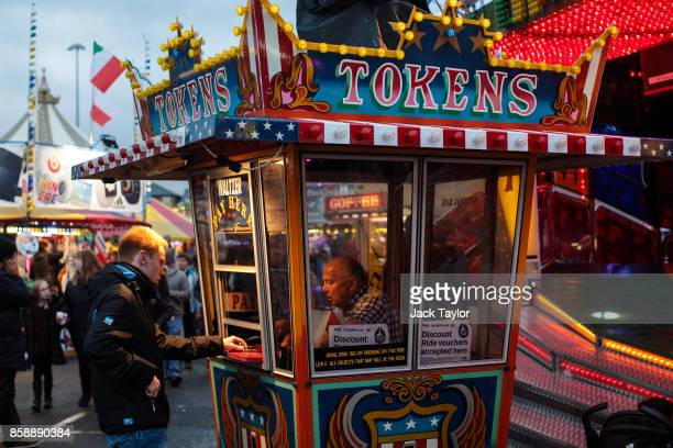 Visitors purchase tokens for a ride at the Nottingham Goose Fair in the Forest Recreation Ground on October 7 2017 in Nottingham England The annual...