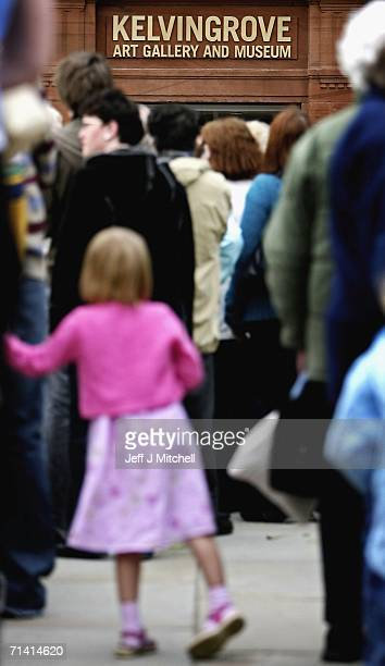 Visitors queue at the doors of the Kelvingrove Art Gallery and Museum on July 11 2006 in Glasgow Scotland The gallery reopened today after a three...