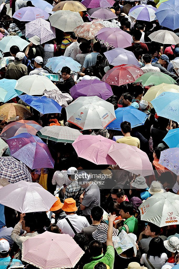 Visitors queue at the site of the World Expo 2010 in Shanghai on June 1, 2010. Organisers expect 70 million visitors -- most of them Chinese -- to attend the biggest-ever World's Fair over the next six months, with an average of 380,000 people expected to visit the site daily.
