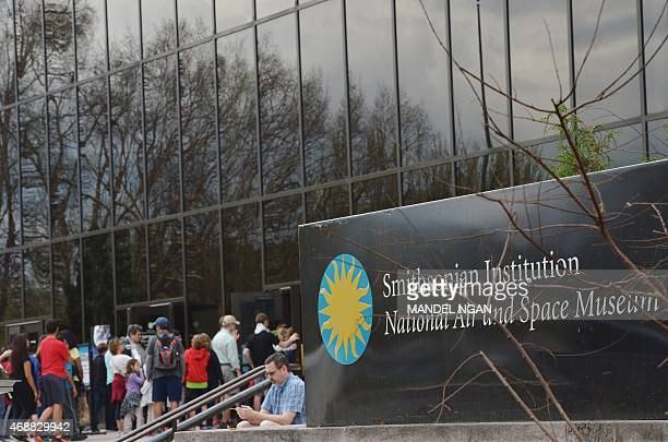Visitors queue to enter the Smithsonian's National Air and Space Museum after it reopened following a power outage on April 7 2015 in Washington DC A...