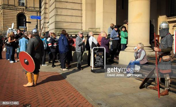 Visitors queue to see the 'Staffordshire Hoard' at Birmingham Museum on the final day of public viewing before being sent to the British Museum for...