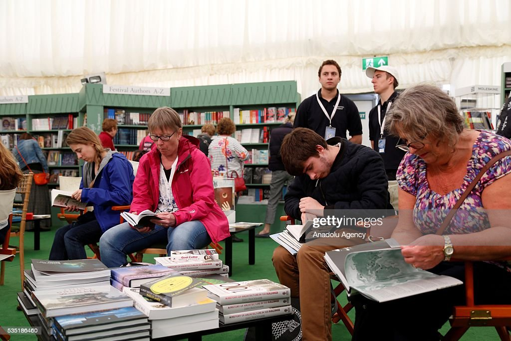 Visitors read books at the Hay Festival, on May 29, 2016 in Hay-on-Wye, Wales. The Hay Festival is an annual festival of literature and arts now in its 29th year.