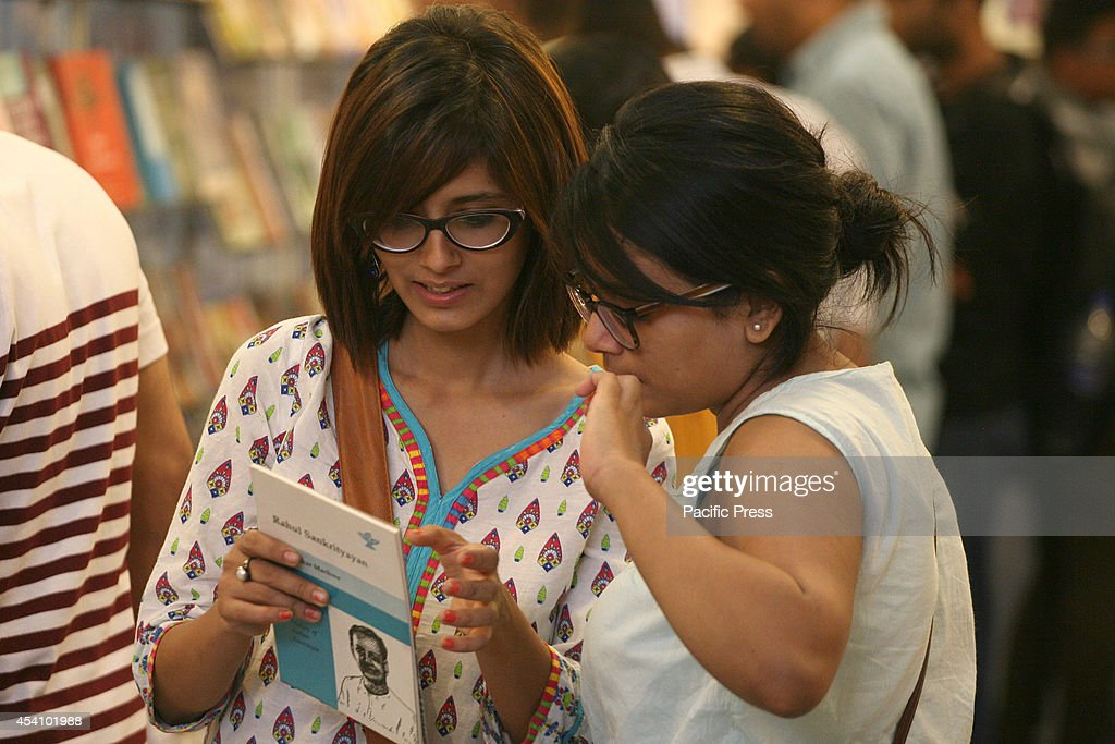 Visitors read books displayed at the 20th Delhi Book Fair organized by the Indian Trade Promotion Organisation (ITPO) and Fedration of Indian Publishers (FIP) in Pragati Maidan.
