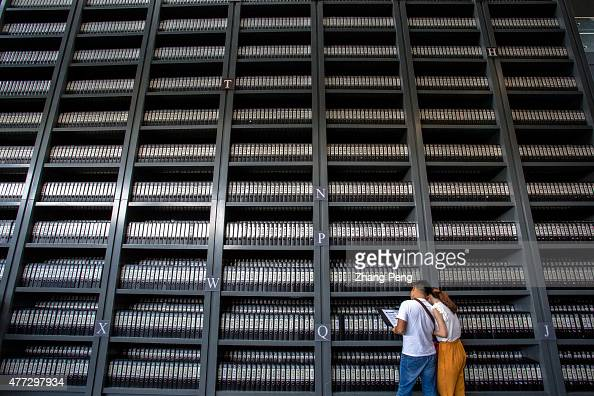 Visitors read the documents of victims in Nanjing Massacre The Nanjing Massacre Memorial Hall located in the southwestern corner of Nanjing is an...