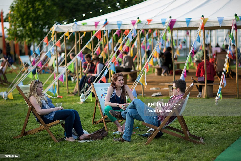 Visitors relax at the Hay Festival, on May 28, 2016 in Hay-on-Wye, Wales.