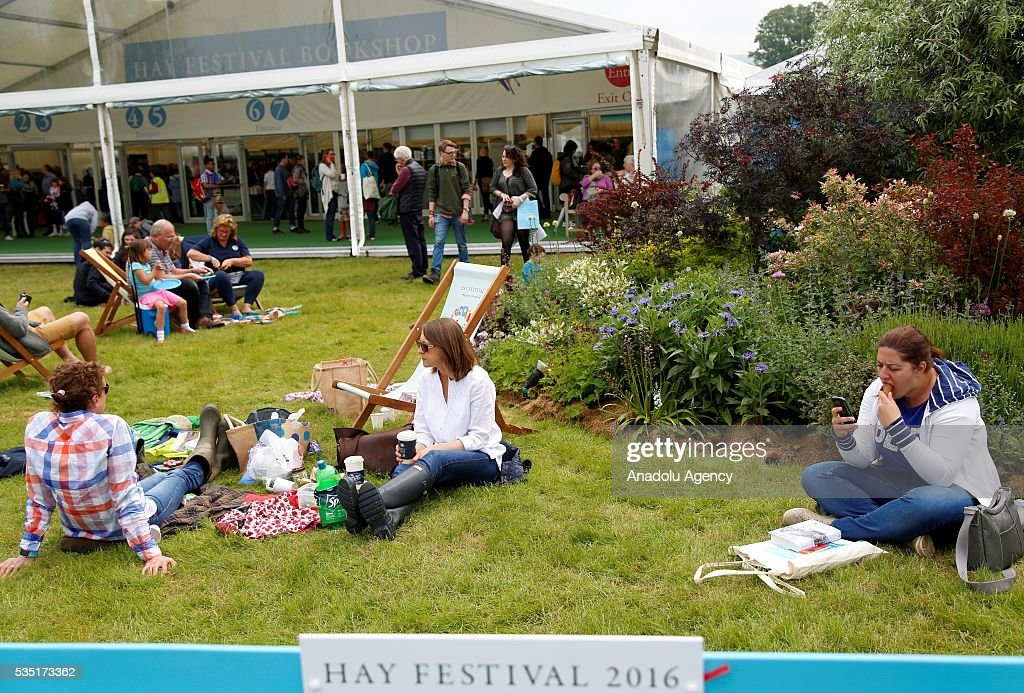 Visitors relax at the Hay Festival, on May 29, 2016 in Hay-on-Wye, Wales. The Hay Festival is an annual festival of literature and arts now in its 29th year.