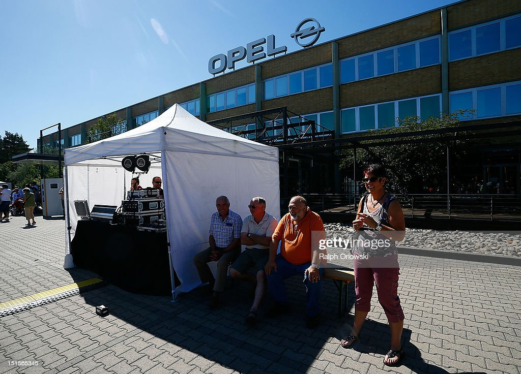Visitors relax in the sun at the manufacturing plant of German car maker Adam Opel GmbH on September 8, 2012 in Kaiserslautern, Germany. Automaker Opel, founded in 1862, celebrates their 150th anniversary.