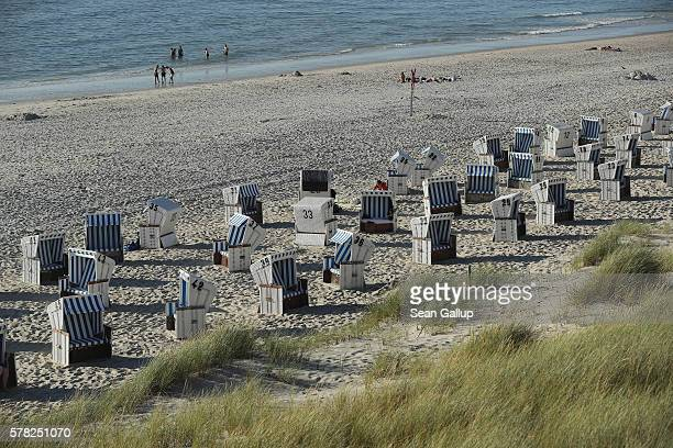 Visitors relax on a beach among beach chairs along the northern end of Sylt Island on July 19 2016 near List Germany Sylt Island with its long...