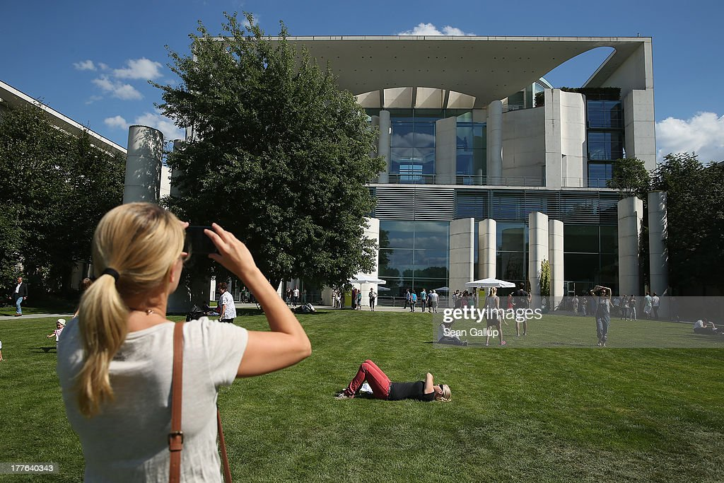 Visitors relax on the back lawn during the annual open-house day at the Chancellery on August 25, 2013 in Berlin, Germany. Approximately 150,000 visitors took advantage of the annual event held at the Chancellery and German government ministries to get an inside glimpse.