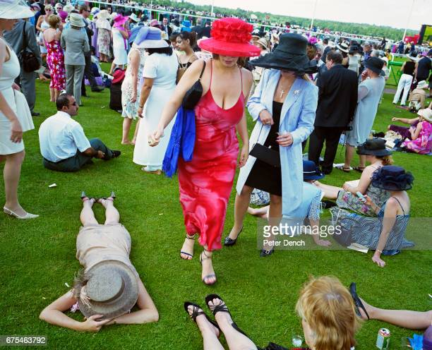 Visitors relax on the grass at Royal Ascot June 2002