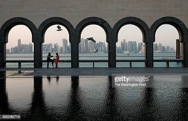 Visitors relax on the grounds the Museum of Islamic Art in Doha Qatar on November 6 2015 The building was designed by IM Pei Doha has numerous...