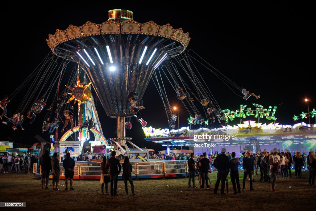 Visitors ride a chair-o-plane at a fun fair during the Guca Trumpet Festival on August 12, 2017 in Guca, Serbia. Thousands of revellers attend the trumpet festival, held annually since 1961 in the small, central Serbian town of Guca. The free event is a celebration of Balkan music with dozens of orchestras and solo trumpeters taking part in the festival's main competition. During the festival wild street parties take place throughout the night as brass bands parade and play for tips to the thousands of visitors in the town's restaurants, bars and pop-up tents.