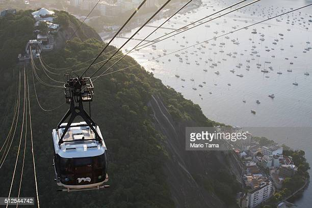 Visitors ride the cable car to the famed Sugar Loaf Mountain a landmark tourist destination in Rio on February 26 2016 in Rio de Janeiro Brazil The...