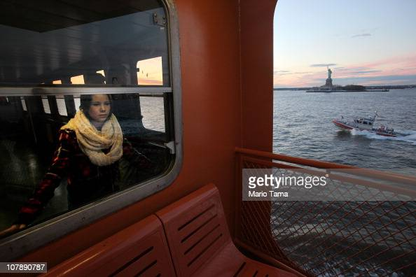 Visitors ride the Staten Island ferry with the Statue of Liberty in the background January 5 2011 in New York City In 2010 New York City drew a...