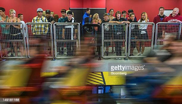 Visitors ride the Superman Ultimate Flight roller coaster at Six Flags Discovery Kingdom amusement park in Vallejo California US on Monday July 2012...