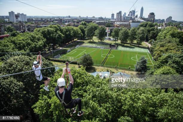 Visitors ride the Zip World zip wire over Archbishop's Park on July 18 2017 in London England The zip wire is 35 metres high at its highest point and...