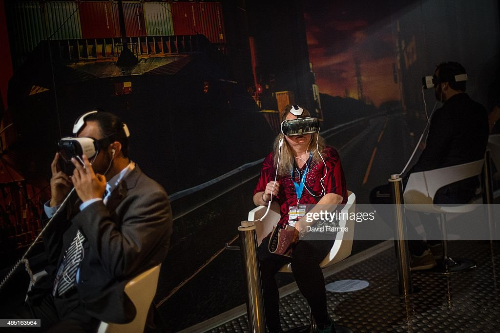Visitors sample a Samsung Gear VR during the second day of the Mobile World Congress 2015 at the Fira Gran Via complex on March 3, 2015 in Barcelona, Spain. The annual Mobile World Congress hosts some of the wold's largest communication companies, with many unveiling their latest phones and wearables gadgets.