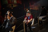 Visitors sample a Samsung Gear VR during the second day of the Mobile World Congress 2015 at the Fira Gran Via complex on March 3 2015 in Barcelona...