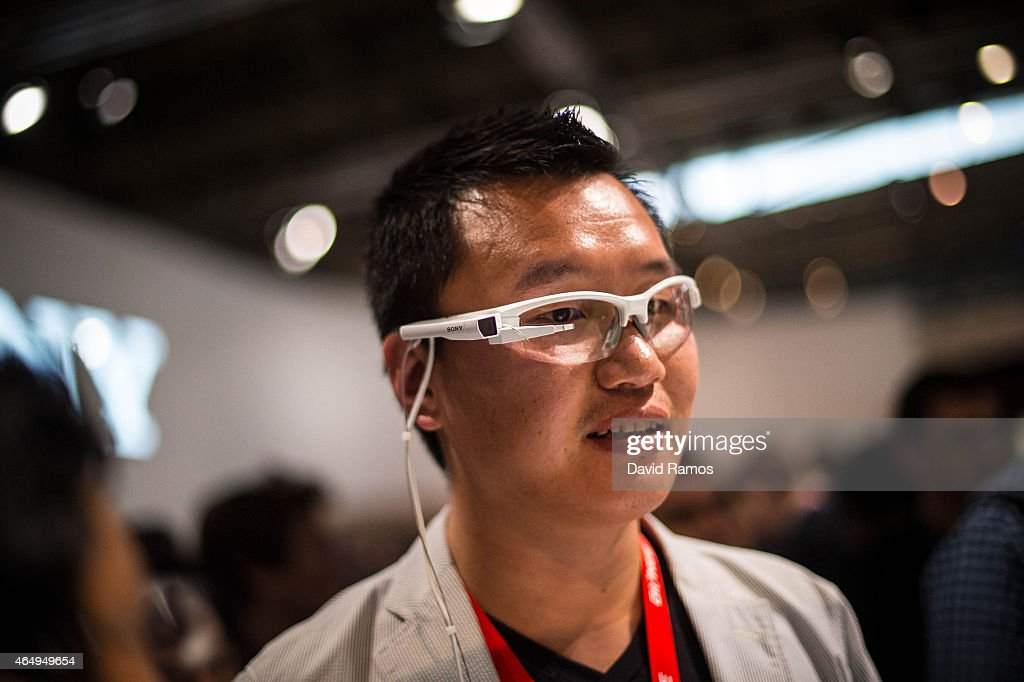 A visitors sample a Sony wearable smart glasses during the first day of the Mobile World Congress 2015 at the Fira Gran Via complex on March 2, 2015 in Barcelona, Spain. The annual Mobile World Congress hosts some of the wold's largest communication companies, with many unveiling their latest phones and wearables gadgets.