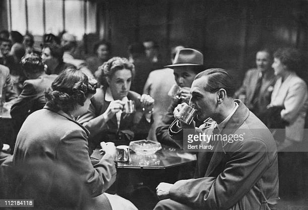 Visitors sampling stout at the St James' Gate Guinness brewery in Dublin 22nd August 1953 Four fifths of Irelands beer is brewed here on the banks of...