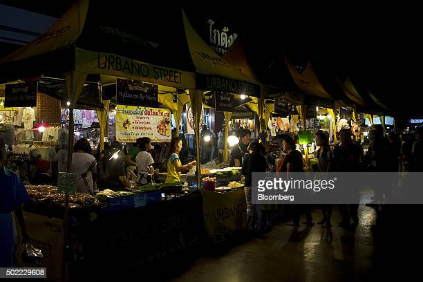 Visitors shop at food stalls at Asiatique The Riverfront openair mall in Bangkok Thailand on Friday Dec 18 2015 Thai economic indicators have shown...