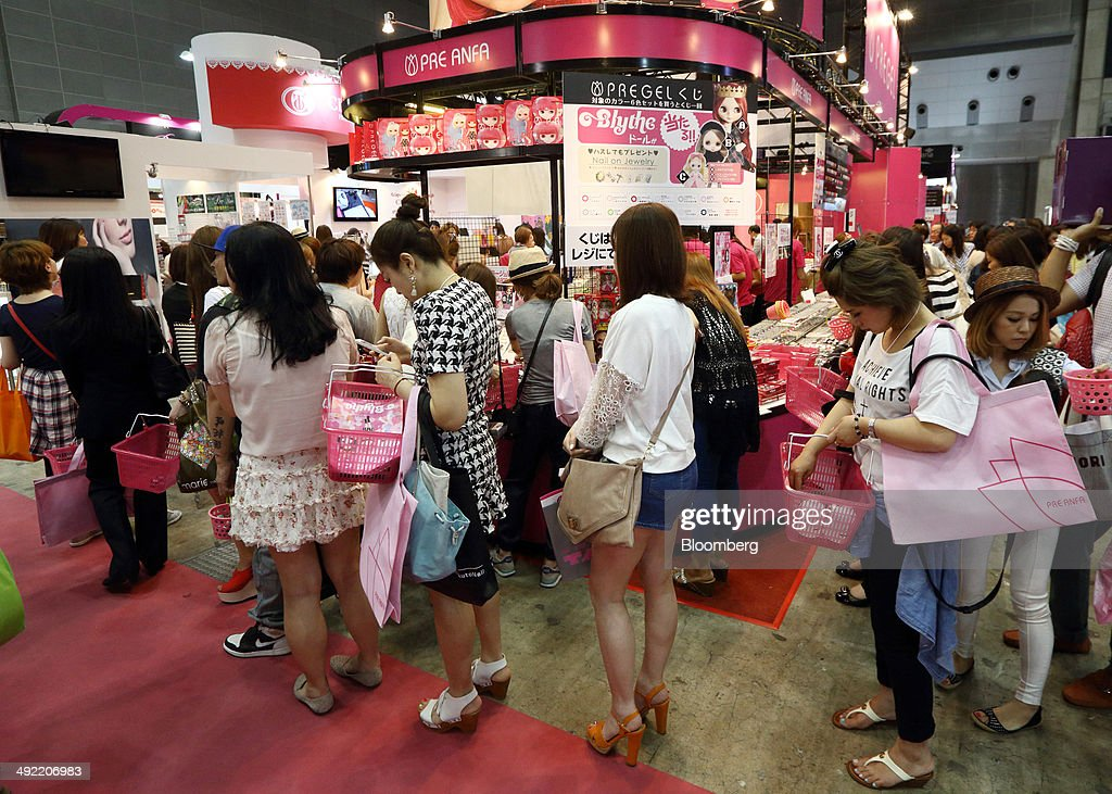 Visitors shop for beauty products at the Beautyworld Japan fair in Tokyo, Japan, on Monday, May 19, 2014. The business-to-business trade fair hosted by Messe Frankfurt is held through May 21. Photographer: Tomohiro Ohsumi/Bloomberg via Getty Images