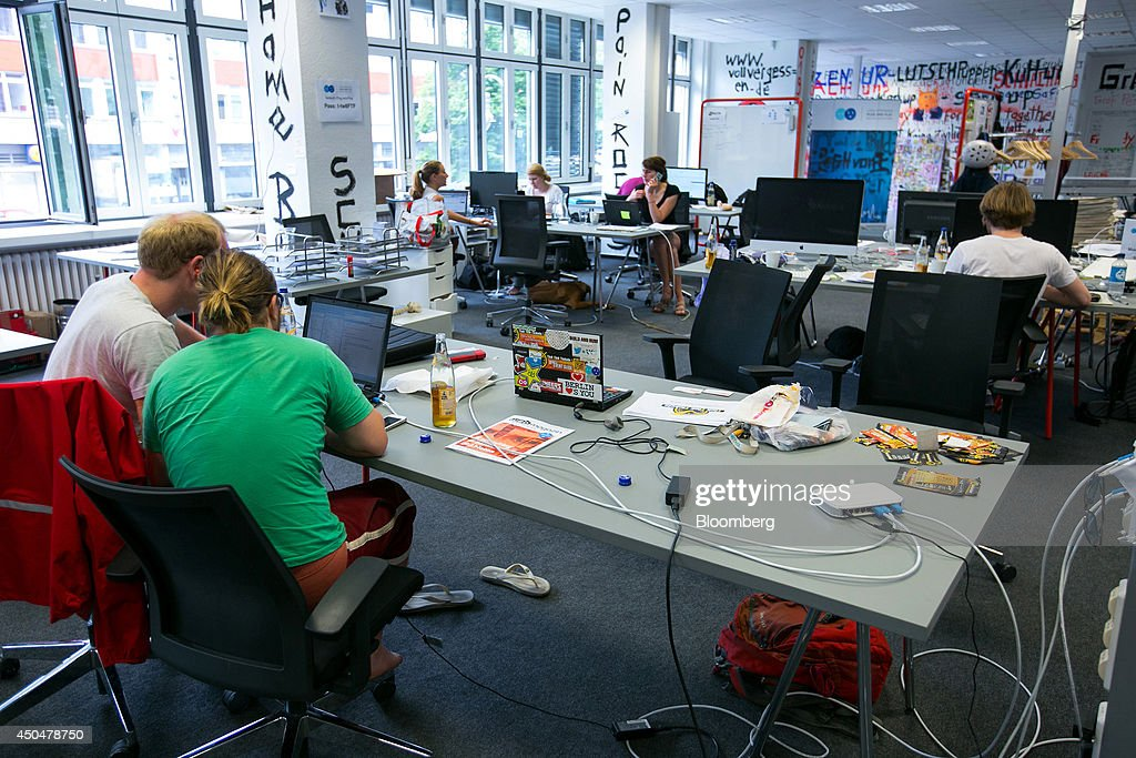 Visitors sit at laptop and desktop computers inside the Plug and Play Accelerator startup business center, jointly run by newspaper publisher Axel Springer SE and Plug and Play Tech Center, in Berlin, Germany, on Wednesday, June 11, 2014. Axel Springer, Europe's biggest newspaper publisher, is working with JPMorgan Chase & Co. and Citigroup Inc. on an initial public offering of its digital-classifieds business, people familiar with the matter said. Photographer: Krisztian Bocsi/Bloomberg via Getty Images