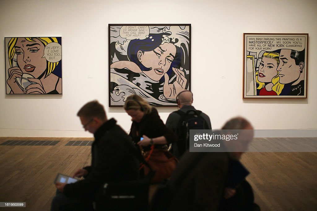 Visitors sit in front of a series of paintings including 'Oh, Jeff... I Love You, Too...But... ' (left) 'Drowning Girl' (centre) and Masterpiece' (right) during a press preview of 'Lichtenstein, a Retrospective' at the Tate Modern on February 18, 2013 in London, England. The painting is part of a retrospective exhibition by 1960's Pop Artist Roy Lichtenstein, the first of its kind in 20 years, which runs at the gallery until May 27, 2013.