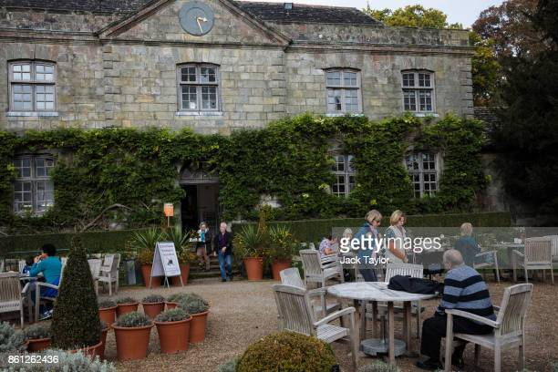 Visitors sit in front of the Stables at Wakehurst 30 years after The Great Storm devastated much of the botanic garden's landscape on October 14 2017...