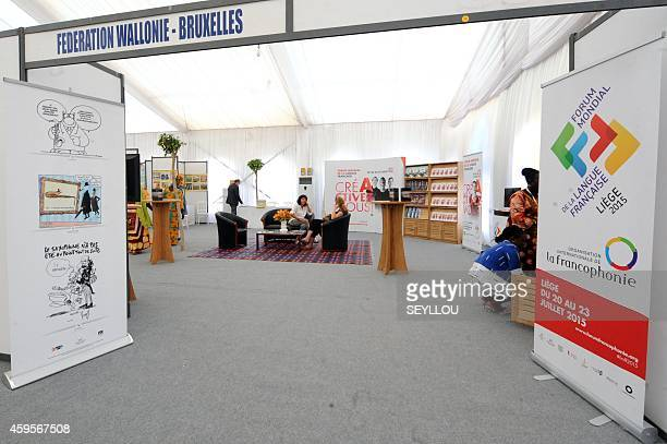 Visitors sit in the booth of the WalloonBrussels Federation in the 'Village de la Francophonie' on November 25 2014 in Dakar ahead of the 15eme...