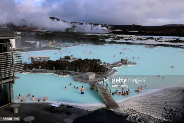 Visitors sit in the geothermal waters at the Blue Lagoon close to the Icelandic capital of Reykjavik on April 7 2014 in Reykjavik Iceland Since the...
