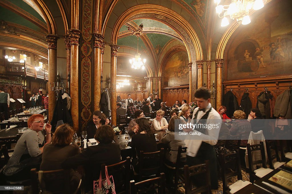 Visitors sit in the ornate Caru cu Bere beer hall and restaurant in the Lipscani old town district on March 7, 2013 in Bucharest, Romania. Both Romania and Bulgaria have been members of the European Union since 2007 and restrictions on their citizens' right to work within the EU are scheduled to end by the conclusion of this year. However, Germany's interior minister announced recently that he would veto the two countries' entry into the Schengen Agreement, which would not affect labour rights but would prevent passport-free travel.