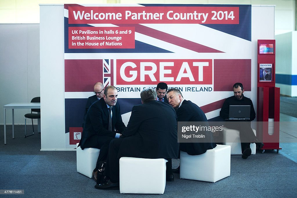 Visitors sit together at the 2014 CeBIT technology Trade fair on March 10, 2014 in Hanover, Germany. CeBIT is the world's largest technology fair and this year's partner nation is Great Britain.