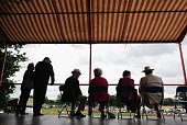 Visitors sit under a tent during a rain shower at the 150th Ryedale Agricultural Show on July 26 2016 in Kirkbymoorside England The Ryedale Show was...