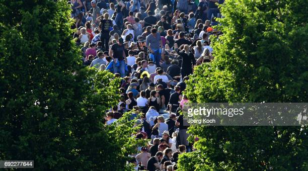 Visitors sitting in the sun at Zeppelinfeld on June 4 2017 in Nuremberg Germany