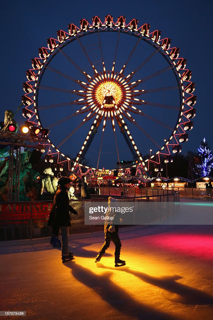 Visitors skate on an ice rink at the annual Christmas market at Alexanderplatz two days after the market opened on November 28, 2012 in Berlin, Germany. Christmas markets, with their stalls selling mulled wine (Gluehwein), Christmas tree decorations and other delights, are an integral part of German Christmas tradition, and many of them are opening across Germany this week.