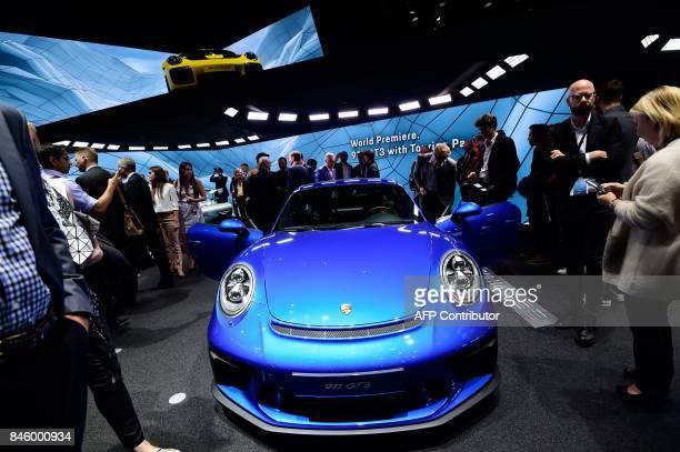 Visitors stand around a Porsche 911 GT3 car at the Internationale Automobil Ausstellung auto show on September 12 2017 in Frankfurt am Main western...