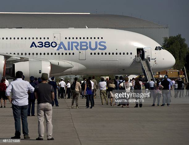 Visitors stand around an Airbus A380 during the XVIII Air and Space Fair in Santiago on March 28 2014 AFP PHOTO/MARTIN BERNETTI
