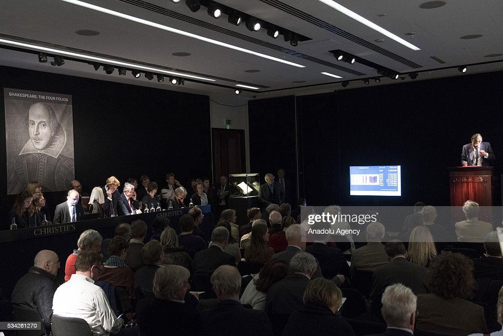 Visitors stand at the sale of First Folio of William Shakespeare's Comedies, Histories, and Tragedies (1623) before it is sold for £1,874,500 at Christies auction in London, United Kingdom on May 25, 2016.