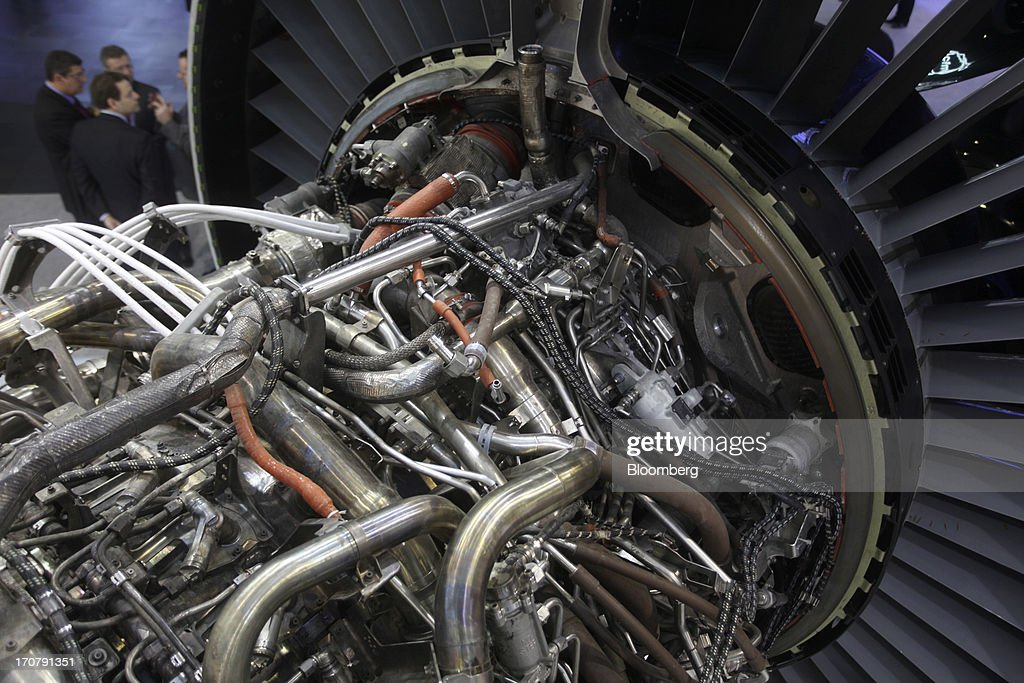 Visitors stand behind a General Electric Co. GEnx aircraft engine on the first day of the Paris Air Show in Paris, France, on Monday, June 17, 2013. The 50th International Paris Air Show is the world's largest aviation and space industry show, and takes place at Le Bourget airport June 17-23. Photographer: Balint Porneczi/Bloomberg via Getty Images