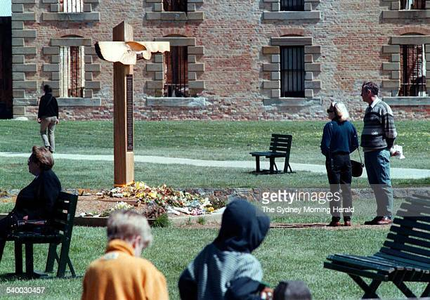 Visitors stand beside the memorial to the victims of the Port Arthur massacre where 35 people were shot and killed in April 1996 Port Arthur historic...