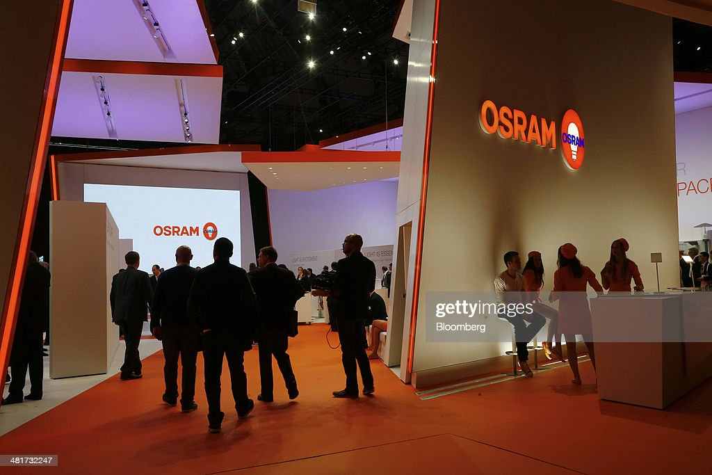 Visitors stand by the Osram Licht AG booth at the Light and Building Architecture and Technology Fair, in Frankfurt, Germany, on Monday, March 31, 2014. The Light and Building Architecture and Technology Fair takes place from March 30 to April 4 2014. Photographer: Ralph Orlowski/Bloomberg via Getty Images