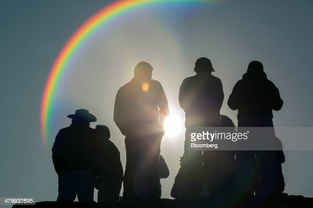Visitors stand facing the sun at the top of the Pyramid of the Sun during celebrations for the Spring Equinox at the archaeological site of...