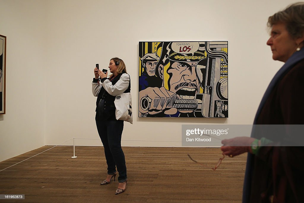 Visitors stand in front of a painting entitled 'Torpedo Los,' during a press preview of 'Lichtenstein, a Retrospective' at the Tate Modern on February 18, 2013 in London, England. The painting is part of a retrospective exhibition by 1960's Pop Artist Roy Lichtenstein, the first of its kind in 20 years. The show runs at the gallery until May 27, 2013.