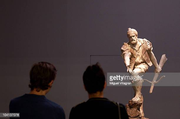 Visitors stand in front of a sculpture depicting Wilhelm Tell by Auguste de Niederhaeusern during the press day of the exhibition Giacometti Hodler...