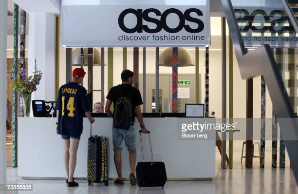 Visitors stand in the reception area at the headquarters of Asos Plc in London UK on Wednesday July 17 2013 Asos Plc the UK's largest onlineonly...